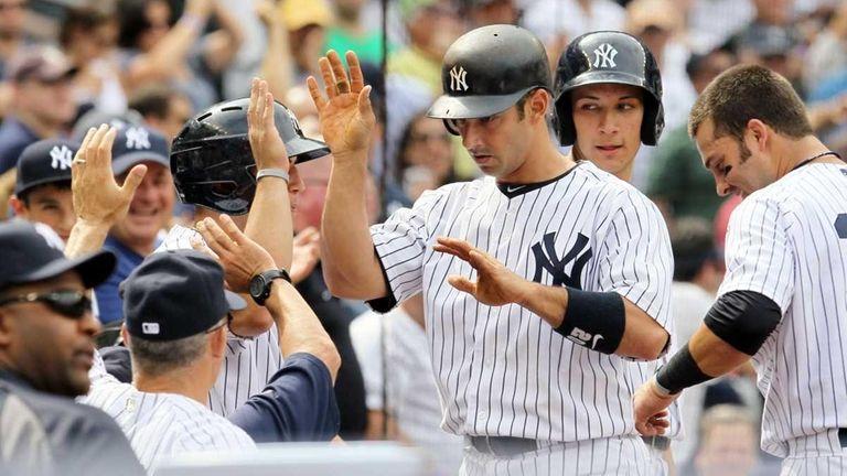 Jorge Posada of the New York Yankees celebrates