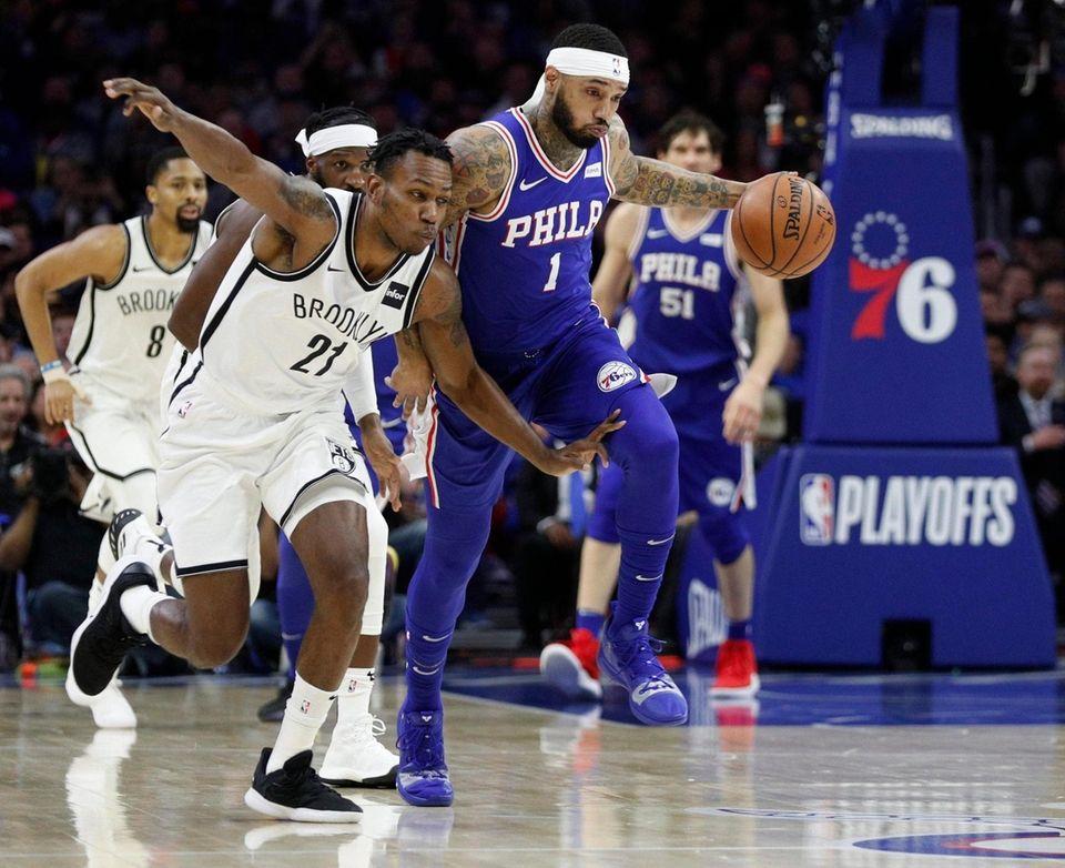 Philadelphia 76ers' Mike Scott, right, drives upcourt against