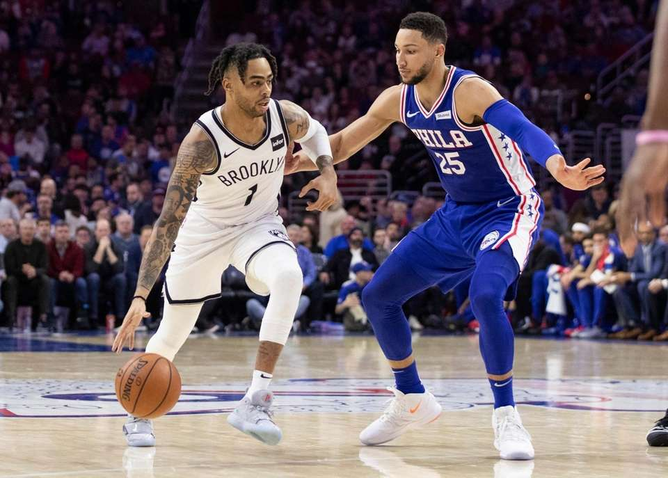 Brooklyn Nets' D'Angelo Russell, left, tries to get