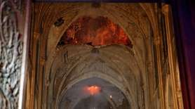 Flames and smoke are seen as the interior