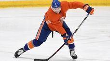New York Islanders defenseman Ryan Pulock skates with