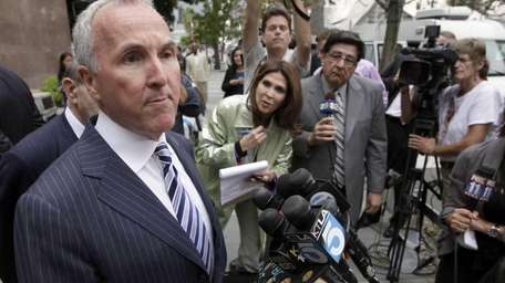Los Angeles Dodgers owner Frank McCourt speaks to