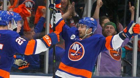 Islanders defenseman Nick Leddy (2) comes to celebrate