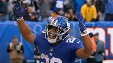 Giants running back Saquon Barkley scores a fourth-quarter