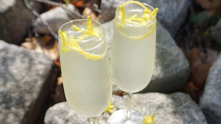 A French 75 cocktail with forsythia syrup, gin,