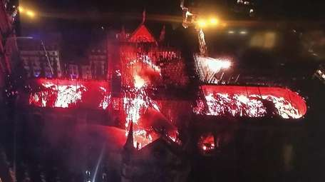 An aerial view of Notre Dame Cathedral engulfed