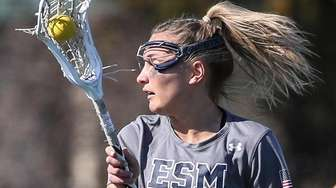 Kasey Choma of Eastport-South Manor looks for a