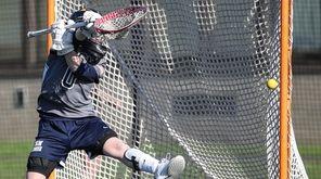 ESM goalkeeper Katie Vahle makes the kick save