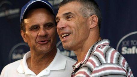 Former Yankees manager Joe Torre, left, knows current