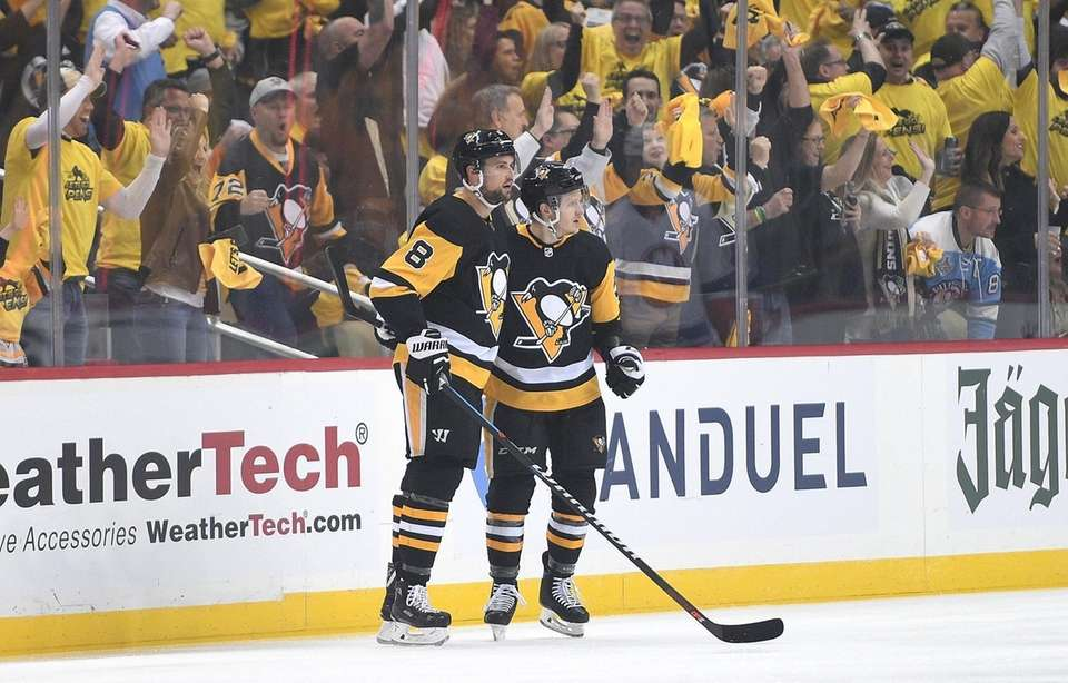 Jake Guentzel of the Penguins celebrates with Brian