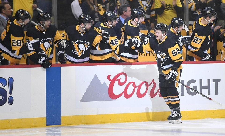 Jake Guentzel of the Penguins celebrates with teammates
