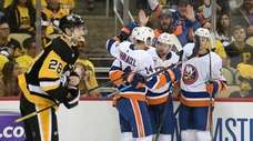 Brock Nelson of the Islanders celebrates with teammates