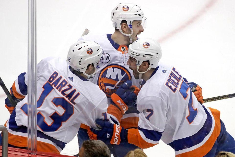 The Islanders' Jordan Eberle celebrates with Adam Pelech,