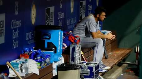 Mets starting pitcher Steven Matz sits in the