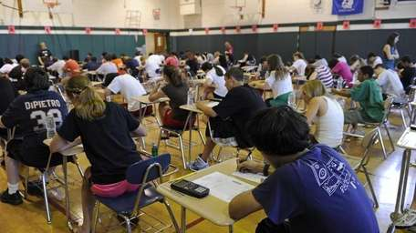 Eighth grade students prepare to take a Regents
