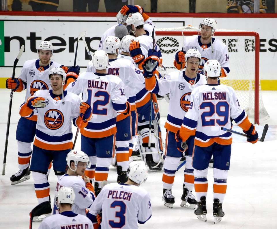 The Islanders celebrate at the end of Game
