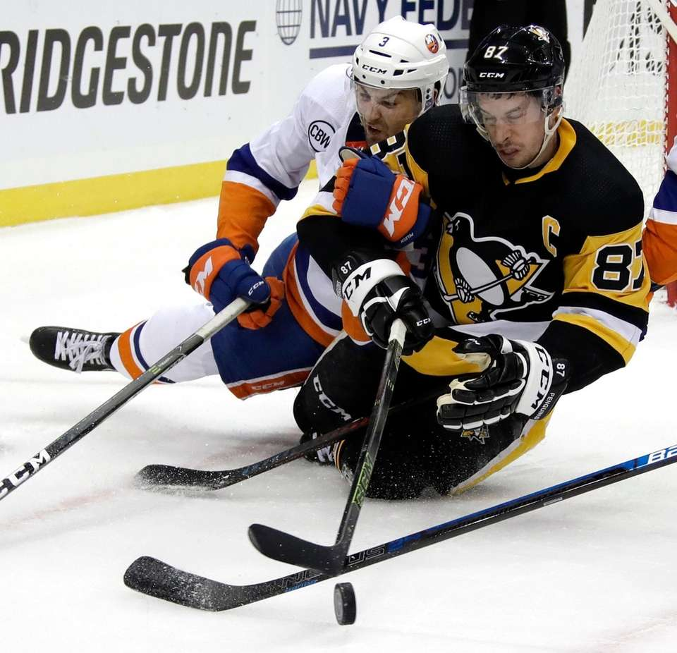 The Penguins' Sidney Crosby and the Islanders' Adam