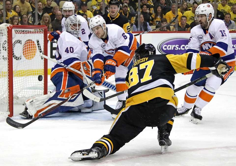 The Penguins' Sidney Crosby can't get a shot
