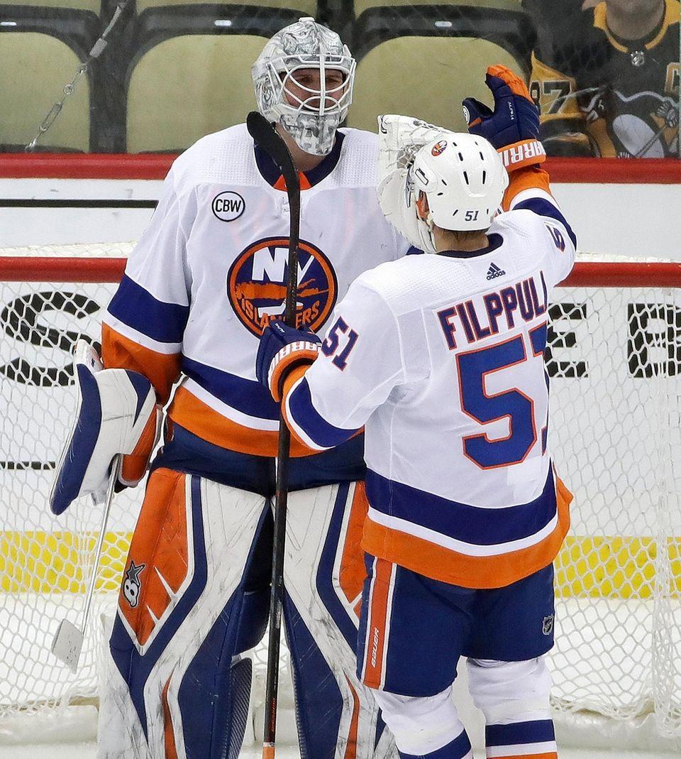 Islanders goaltender Robin Lehner celebrates with Valtteri Filppula
