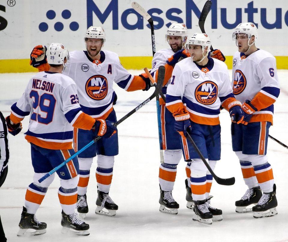 The Islanders' Josh Bailey celebrates his empty-net goal