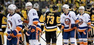 Anders Lee of the Islanders shakes hands with
