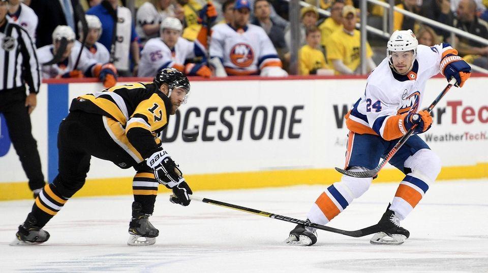 Scott Mayfield of the Islanders dumps the puck
