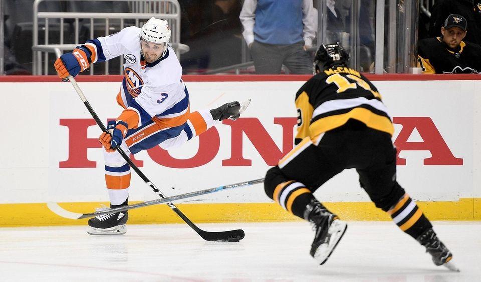 Adam Pelech of the Islanders attempts a shot