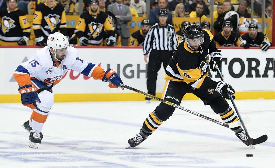 Justin Schultz of the Penguins controls the puck