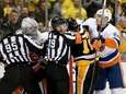 Robin Lehner of the Islanders exchanges punches with