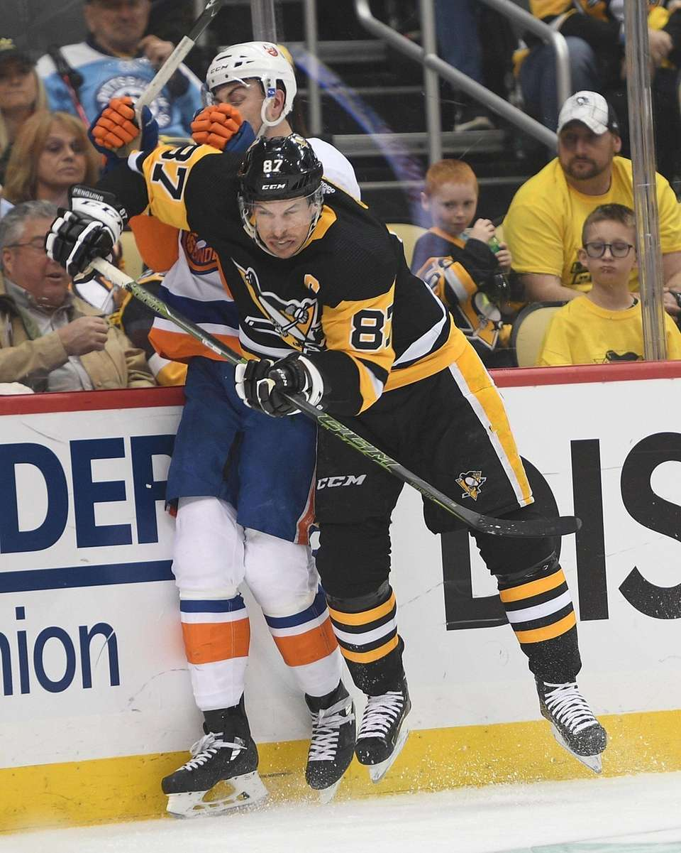Sidney Crosby of the Pittsburgh Penguins checks Adam