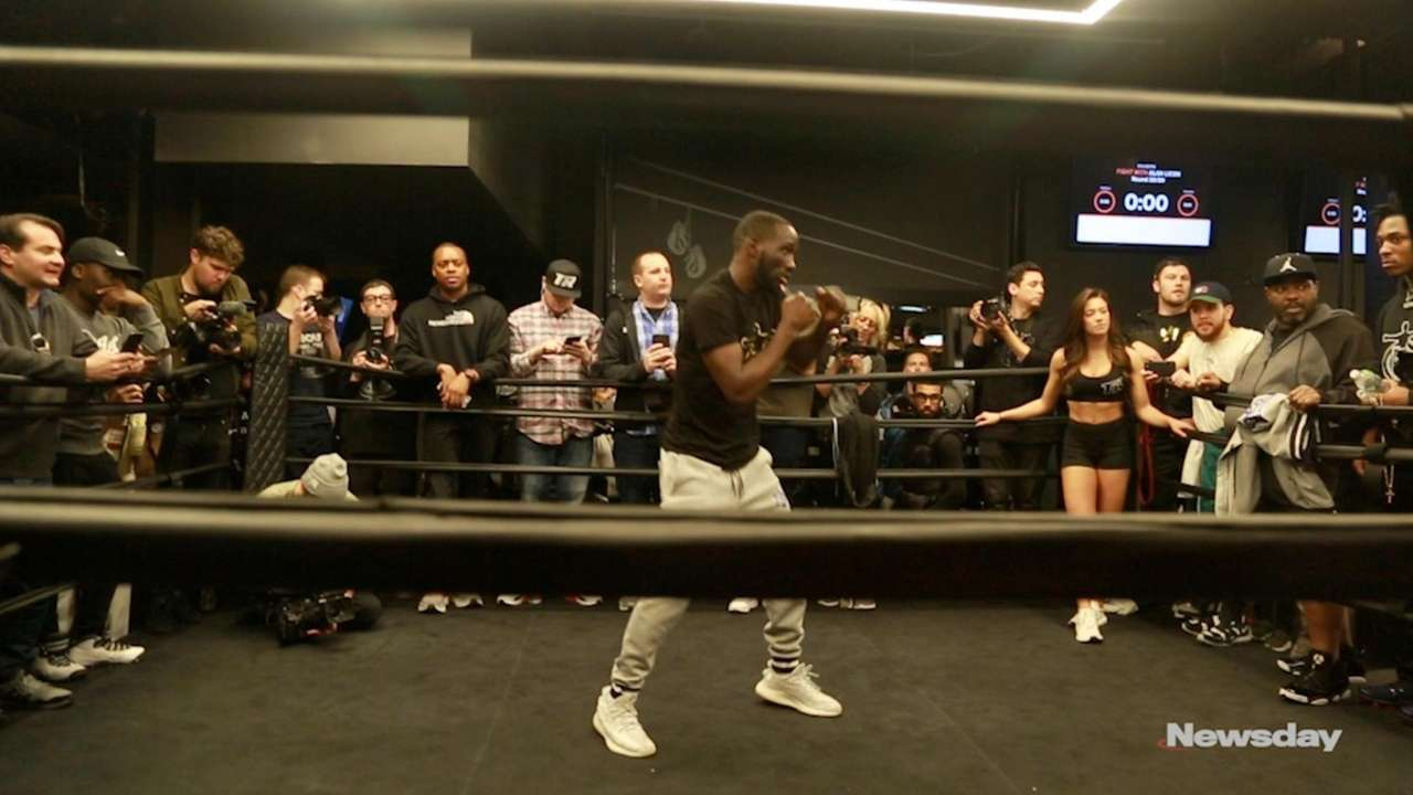 WBO welterweight champion Terence Crawford and challenger Amir