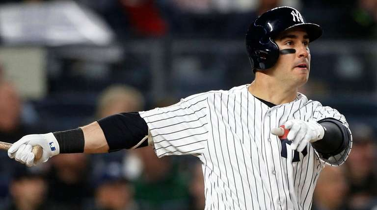 Mike Tauchman of the Yankees follows through on