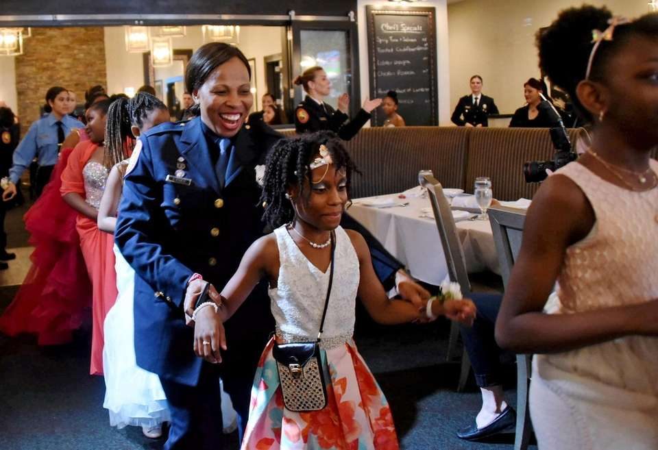 Nassau County Police Officer Yolanda Turner, center, dances