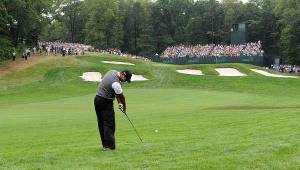 Tiger Woods hits a shot at the 2009