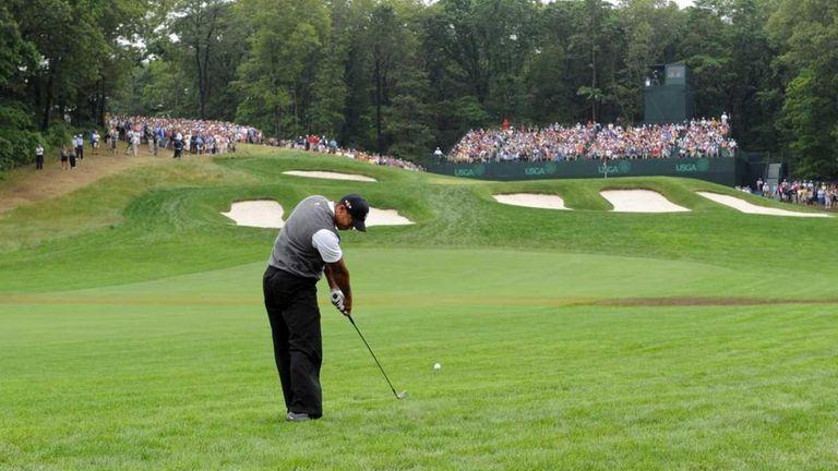 Tiger Woods hits a shot at the 2009