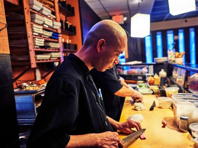 Chef Tony preparing for an omakase meal at