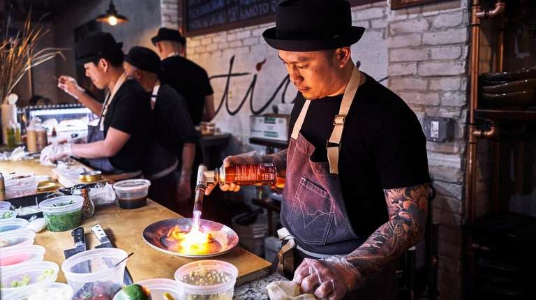 Chef Roy Kurniawan working in the kitchen at