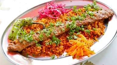 Beyti kebab, ground lamb flavored with garlic, parsley,