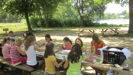 Children participate in a summer arts camp at