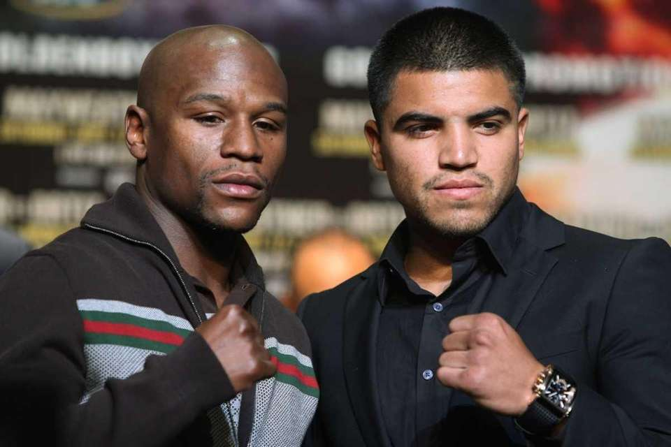 Floyd Mayweather and Victor Ortiz face off at