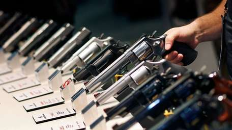 Handguns are displayed at the Smith & Wesson