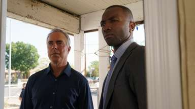 Titus Welliver, left, as homicide Det. Harry