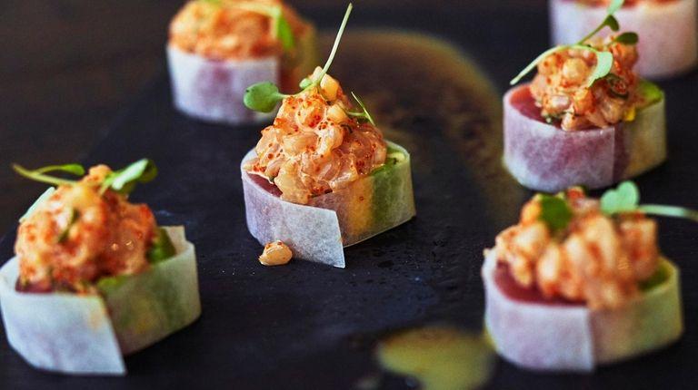 Tuna and salmon meet avocado and mango in