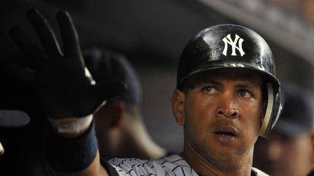 Yankees third baseman Alex Rodriguez is congratulated after