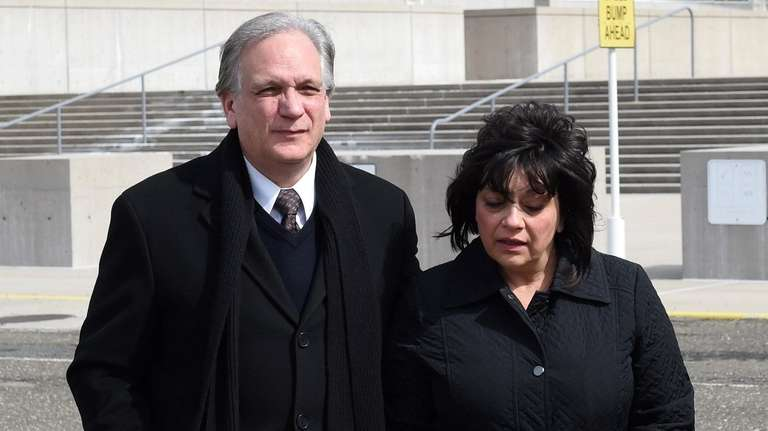 Edward and Linda Mangano outside federal court in