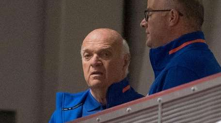 Islanders general manager Lou Lamoriello watching team on
