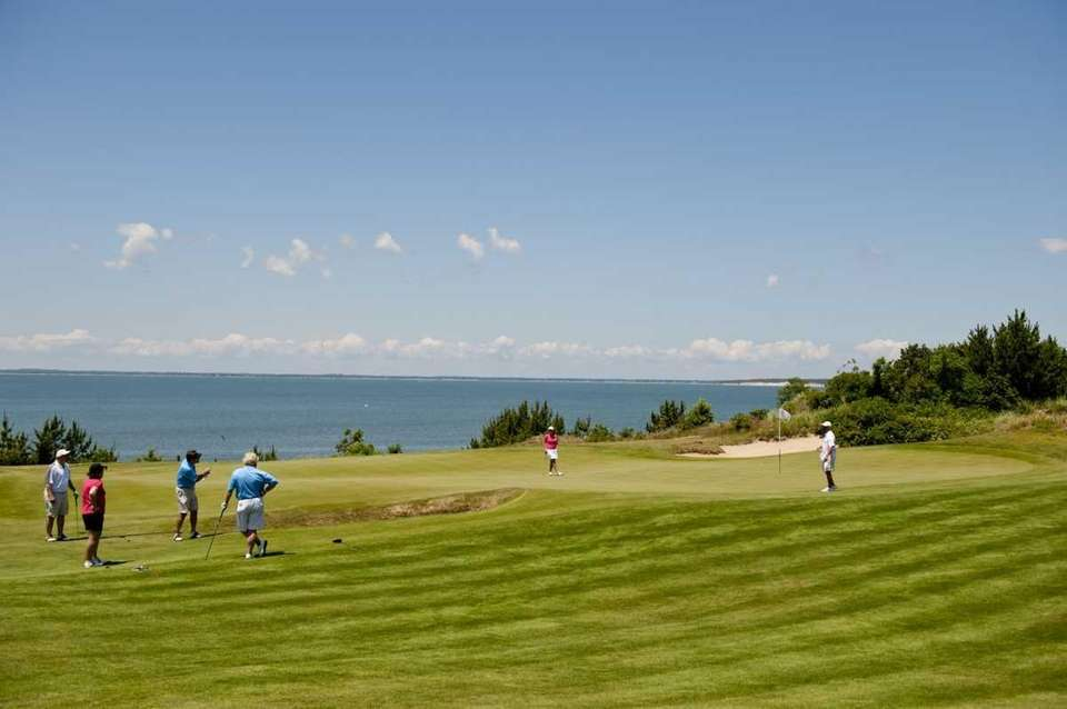 A view of golfers on the 18th hole