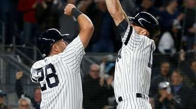 Brett Gardner, right, celebrates his seventh-inning grand slam