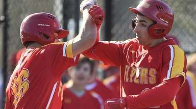 Paul Orbon #12 of Chaminade, right, gets congratulated