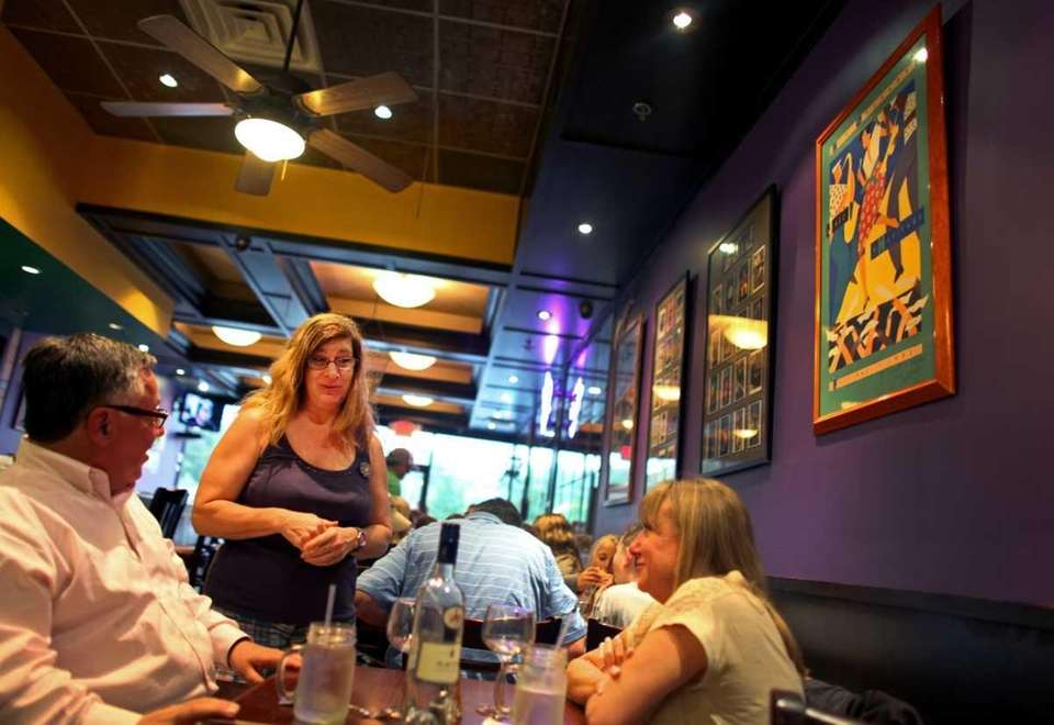 Executive chef Mara Levi chats with patrons at